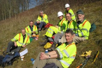 Photo of roadside conservation volunteers resting