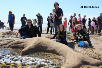Families making sandsculptures at the beached art competition