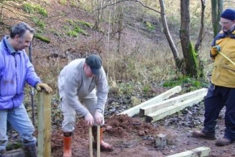 Grubins Wood volunteers constructing a wooden boardwalk