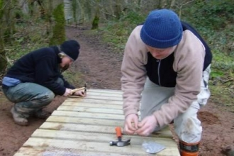 Volunteers repairing the boardwalk at Wreay Woods Nature Reserve