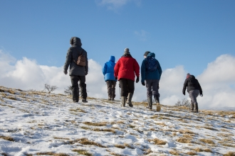 Walkers at Eycott Hill in the snow
