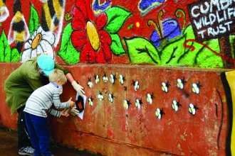 Image of people decorating Florence Mine as part of Get Cumbria Buzzing event in Egremont