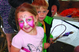 Image  of children making willow wands at Get Cumbria Buzzing event in Egremont