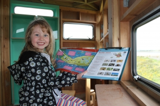image of kid in a South Walney hide doing the junior kids story trail - the douglas family