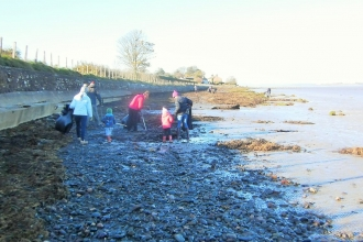 Family enjoying a beach clean at Bowness on Solway