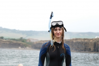 Heather in a wetsuit in the sea