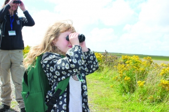 Image of child bird watching at South Walney Nature Reserve