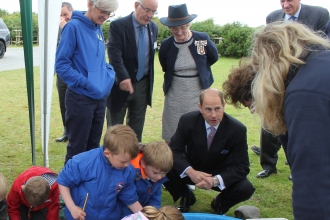 Image of HRH The Earl of Wessex visiting South Walney Nature Reserve with schoolchildren