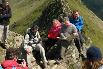 Jamie normington on Helvellyn reading the Lost Words for Cumbria