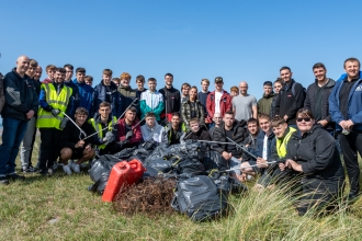 Apprentices from BAE Systems help clean up rubbish on the beaches at South Walney Nature Reserve