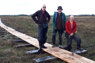 Image of volunteers with new boardwalk at Drumburgh Moss