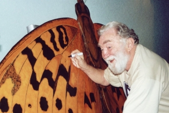 Image of David Bellamy signing BAP butterfly