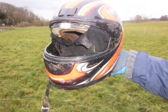 Motorcycle crash helmet found in the sand