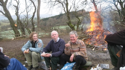 Volunteers taking a break by a bonfire