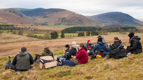 Volunteers enjoying lunch at Eycott Hill © Ben Wolstencroft
